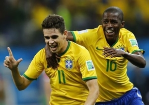 Brazil's Oscar (L) and Ramires celebrate during the 2014 World Cup opening match between Brazil and Croatia at the Corinthians arena in Sao Paulo